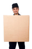 Young boy delivering parcel Royalty Free Stock Photos