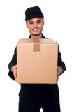 Young boy delivering parcel safely Royalty Free Stock Images