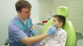 Young boy and dentist stock footage