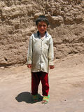 Young boy in desert town, Iran Royalty Free Stock Image