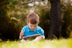 Young Boy with Digital Tablet Royalty Free Stock Images