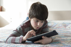 Young boy and a digital tablet royalty free stock photography