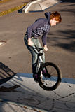 Young boy with dirtbike in halfpipe Stock Image