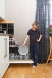 Young Boy by the Dishwasher Royalty Free Stock Image