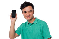 Young boy displaying brand new cellphone Royalty Free Stock Images