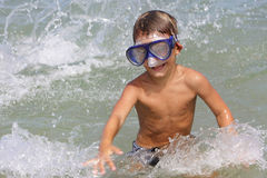 Young boy in diving mask in water Stock Photos
