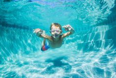 Young Boy Diving Underwater in Swimming Pool Royalty Free Stock Images