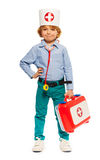 Young boy in doctors cap and with toy instruments Stock Photography