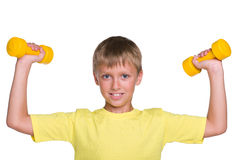 Young boy does exercises with dumbbells Stock Photos