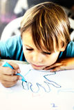 A young boy is doing drawing Stock Photo