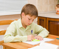 Young boy doing his homework. At home Royalty Free Stock Image