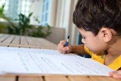 Young boy doing his homework Stock Photo