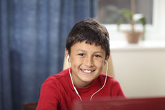 Young boy doing his homework Stock Photo