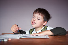 Young boy doing his homework at home. This image has attached release stock photos