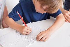 Young boy doing homework Stock Photography