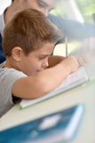 Young boy doing homework with his father Royalty Free Stock Photography