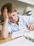 Young Boy Doing Homework In His Room Royalty Free Stock Photo