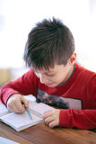 Young boy doing homework Stock Photo