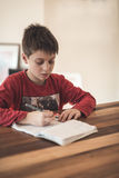 Young boy doing homework Stock Photos