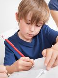 Young boy doing homework Royalty Free Stock Photo