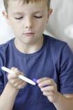 Young boy doing homework Stock Photo