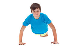 Young boy doing push ups - front view Royalty Free Stock Photography