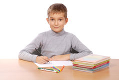 Young boy doing school work Stock Photos