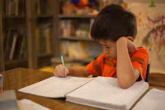 Young boy doing school work Stock Photo