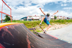 Young boy doing the trick on the ramp Royalty Free Stock Photography