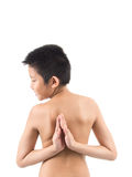 Young boy doing yoga exercise in Virasana Stock Images