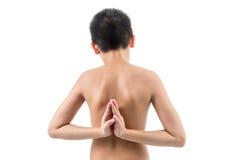 Young boy doing yoga exercise in Virasana Royalty Free Stock Photo