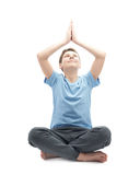 Young boy doing yoga Stock Photography