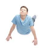 Young boy doing yoga Stock Photo