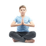 Young boy doing yoga Royalty Free Stock Image