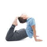 Young boy doing yoga Stock Photos