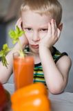 Young boy don't like vegetables. Young sad boy don't like vegetables Royalty Free Stock Photos