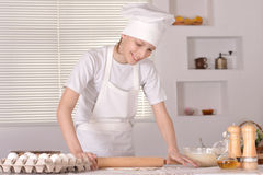 A young boy with dough Stock Photography