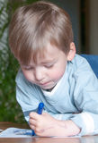 Young boy drawing Stock Photography