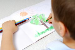 Young boy drawing Stock Images