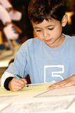 Young boy drawing with crayon Royalty Free Stock Images