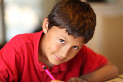 Young boy drawing for homework Royalty Free Stock Image