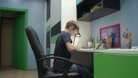 Young boy drawing a picture copying it from digital tablet