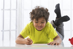 Young boy drawing royalty free stock photo