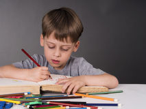 Young boy drawing Royalty Free Stock Photos