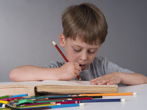 Young boy drawing Royalty Free Stock Images