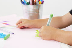 Young boy drawing at table Stock Photos