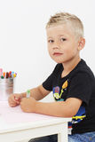 Young boy drawing at table Royalty Free Stock Photography
