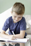Young boy drawing and writing Stock Images