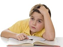 Young boy dreaming at homework Stock Photos