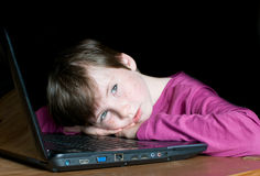 Young boy dreaming on laptop Royalty Free Stock Images